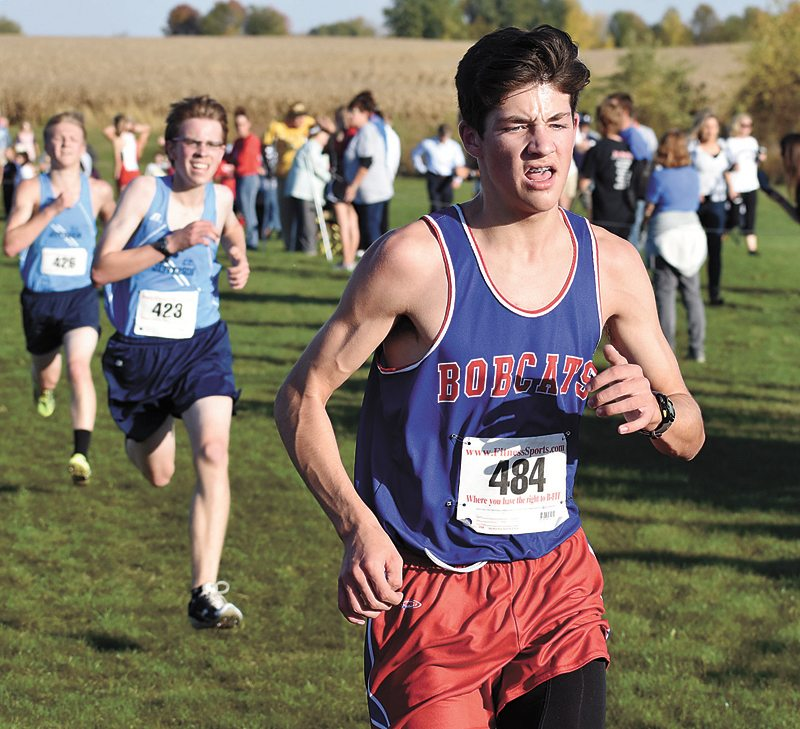 T-R PHOTO BY THORN COMPTON • Marshalltown freshman Eli Thiesen, right, exerts the last of his energy as he nears the finish line during the Class 4A state-qualifying meet at the Marshalltown Community College cross country course on Thursday.