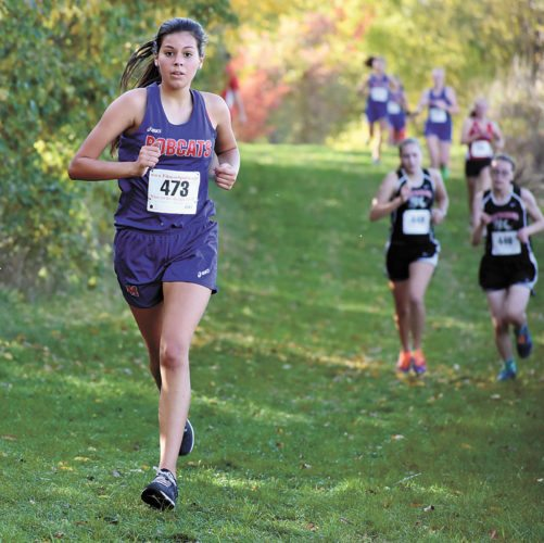 T-R PHOTO BY THORN COMPTON • Marshalltown freshman Odaly Flores, left, makes her way through the cross country course at Marshalltown Community College on Thursday during the Class 4A state-qualifying meet.