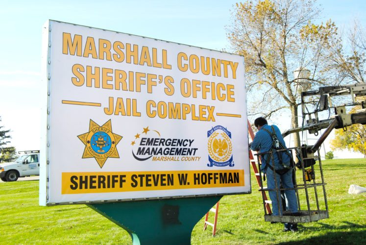 Work took place this week to install new signage at the Marshall County Sheriff's Office. Following his election last November, Marshall County Sheriff Steve Hoffman ordered the replacement signs this past June to reflect a change in leadership as well as the addition of the Marshall County Emergency Management office, which is also within the facility, located along Highway 30 and Jessup Avenue.