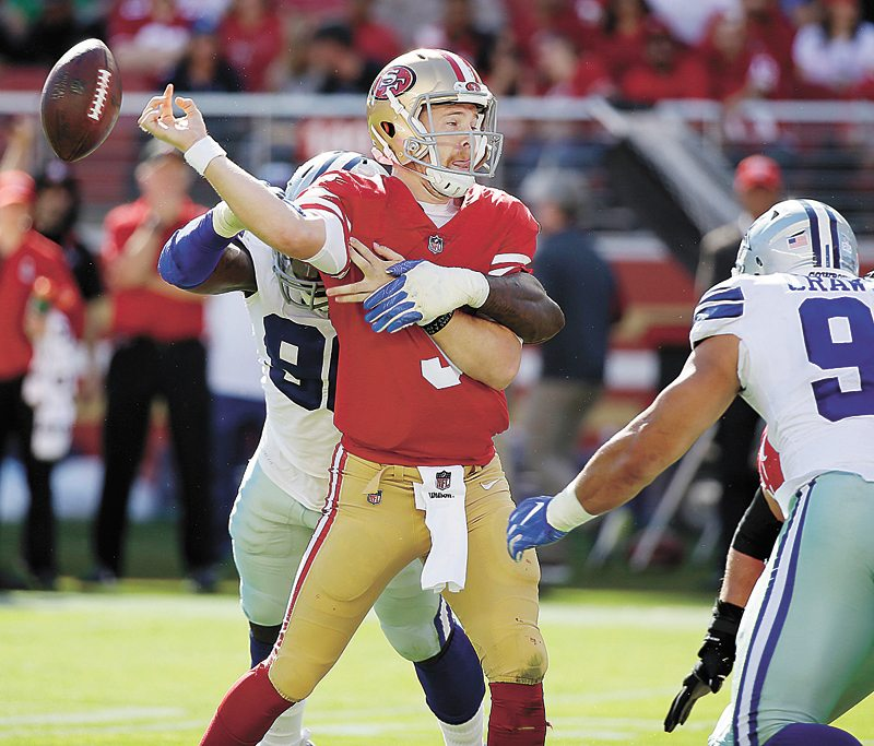 AP PHOTO • San Francisco 49ers quarterback C.J. Beathard (3) fumbles as he is hit by Dallas Cowboys defensive end Demarcus Lawrence during the first half of Sunday's NFL game in Santa Clara, Calif.