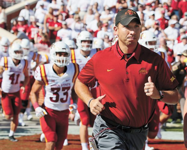 AP FILE PHOTO • Iowa State head football coach Matt Campbell runs onto the field with his team before a Big 12 Conference football game against Oklahoma on Oct. 7 in Norman, Okla. The Cyclones beat the then-No. 3 Sooners to start a string of three-straight wins that have propelled Iowa State into The Associated Press Top 25 rankings at No. 25.
