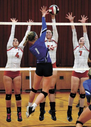 T-R PHOTO BY ROSS THEDE • North Tama puts up a triple block against Collins-Maxwell's Josie Wierson (1) during the first set of Monday's Class 1A Region 4 quarterfinal in Traer. Defending on the play for the Redhawks were Isabel Sierra (4), Lydia Schafer (center) and Karly Jans (7).