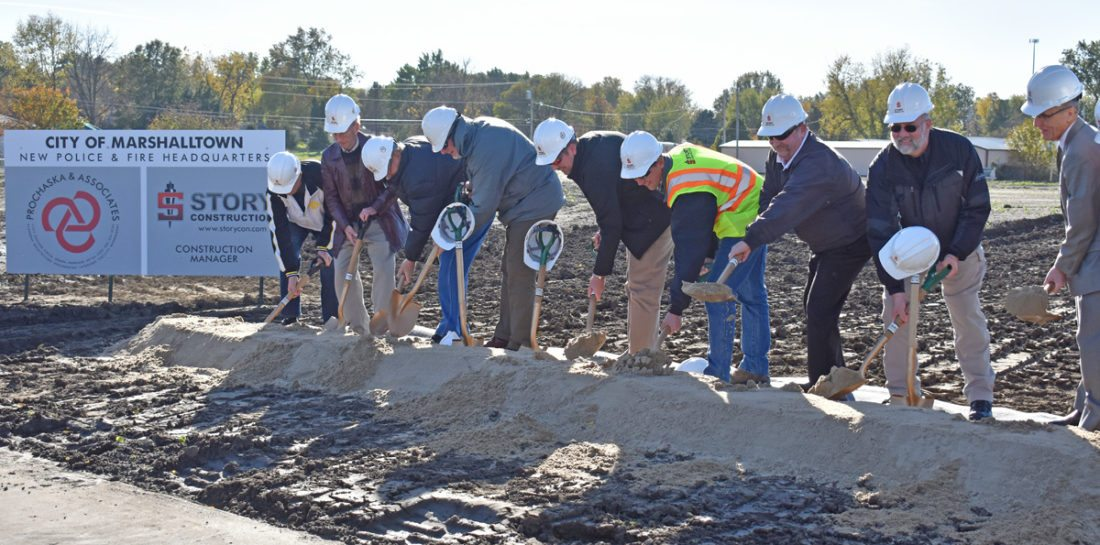 T-R PHOTO BY MIKE DONAHEY  Dirt flies from shovels at the Marshalltown Police Department and Fire Department headquarters groundbreaking Tuesday in the 900 block of South Second Street. Making remarks were Mayor Jim Lowrance, Chief of Police Michael Tupper, Fire Chief David Rierson, and Councilor-At-Large Bill Martin.