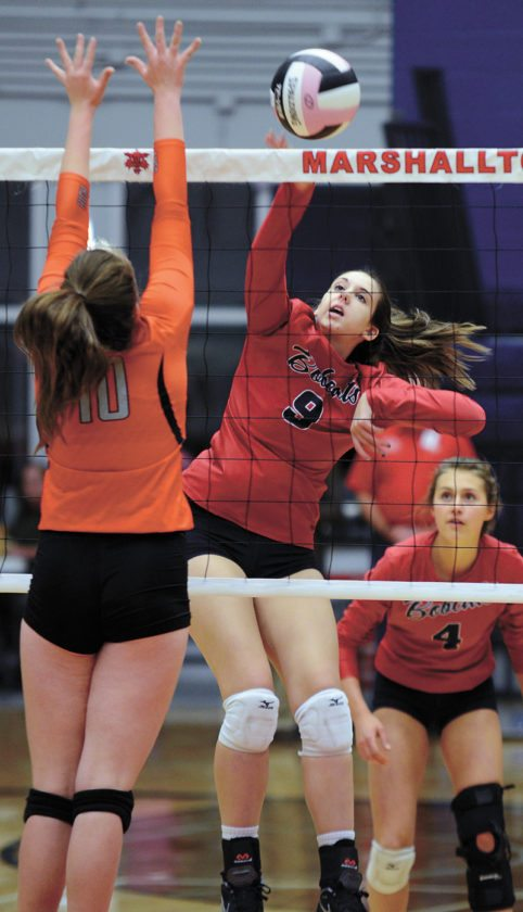 T-R PHOTO BY ROSS THEDE • Marshalltown senior middle hitter Molly Bach (9) goes up for one of her season-high 10 kills during the first set of the Bobcats' three-game sweep of Ames in Tuesday's Class 5A Region 6 semifinal at the Roundhouse. Casey Hinders (10) defends for Ames while Emily Hass (4) looks on for the No. 15 Bobcats, who swept the Little Cyclones 25-22, 25-13, 25-19.