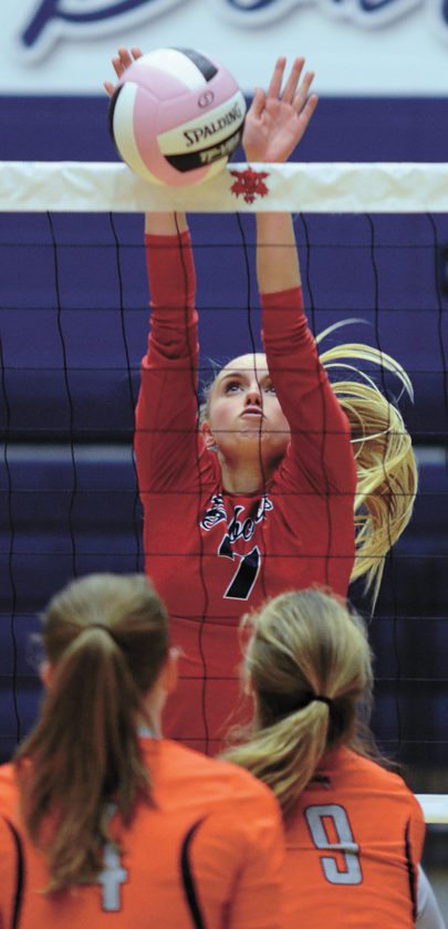 T-R PHOTO BY ROSS THEDE • Marshalltown senior outside hitter Ciara Feldman, top, blocks an Ames pass at the net during the first set of Tuesday's Class 5A Region 6 semifinal at the Roundhouse. Feldman matched her career-high with 17 kills in the Bobcat victory.