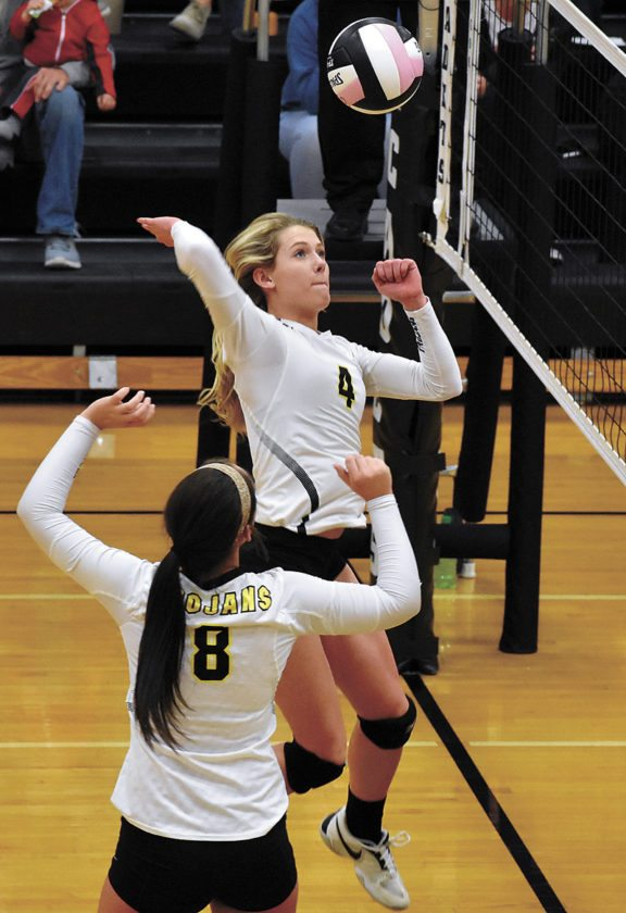 T-R PHOTO BY THORN COMPTON • West Marshall's Addison Moore (4) prepares to attack the set from Trojan senior Grace Porter (8) during Tuesday's Class 3A Region 6 semifinal against No. 12 Iowa Falls-Alden in Iowa Falls. The host Cadets won in five sets, 20-25, 25-27, 28-26, 25-22, 15-11.