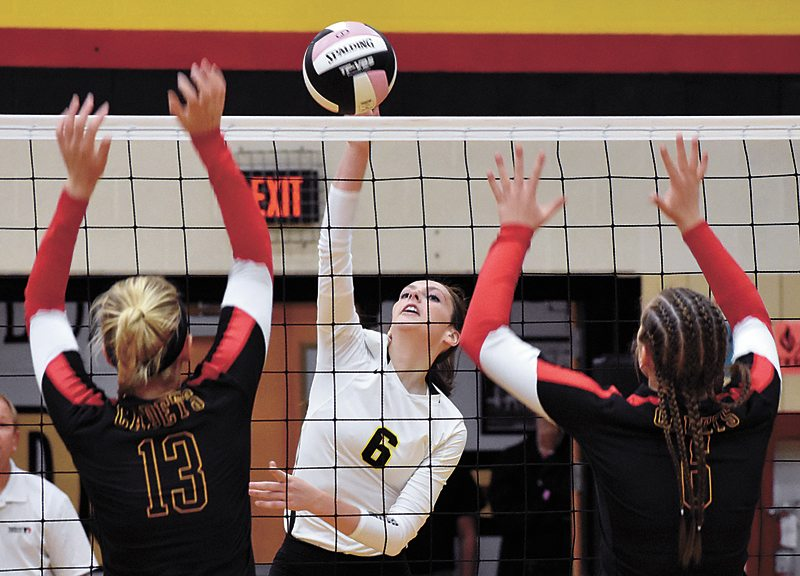 T-R PHOTO BY THORN COMPTON • West Marshall junior outside hitter Catherine Sjoblom, center, swings against Iowa Falls-Alden blockers Grace Renaud, left, and Hannah Redmond, right, during Tuesday's Class 3A Region 6 semifinal in Iowa Falls.