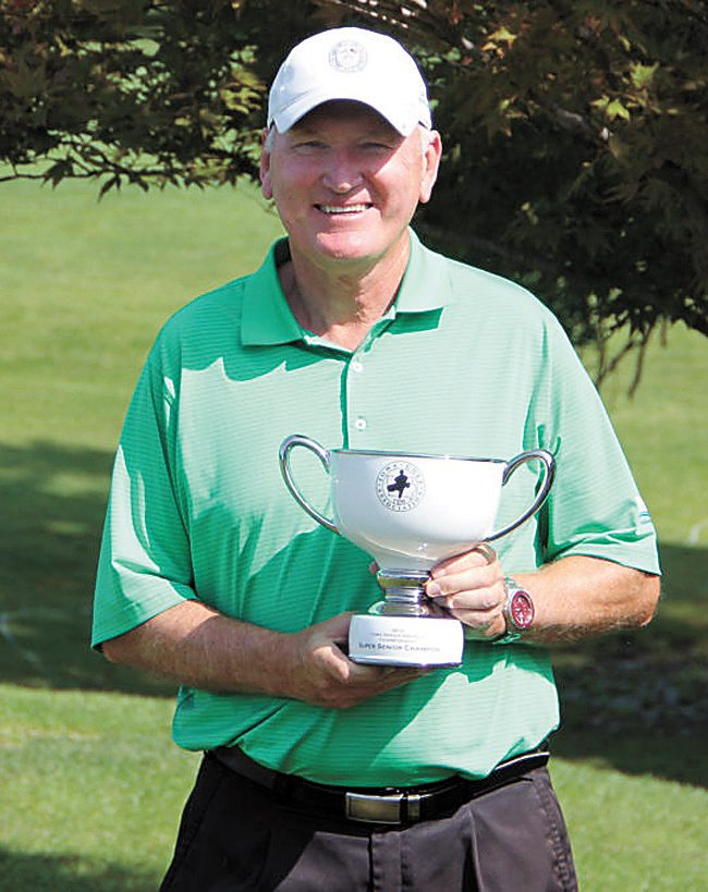 PHOTO PROVIDED • Rob Christensen poses with his trophy after being named the Super Senior Player of the Year by the Iowa Golf Association.