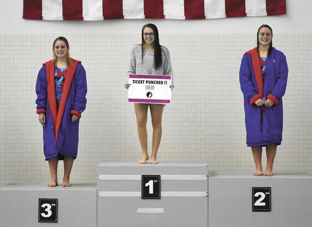 T-R PHOTO BY THORN COMPTON • Marshalltown junior divers Sami, left, and Alli Trowbridge, right, stand on the podium next to first-place winner Annie Noll, from Dowling Catholic, after they receive their second and third place medals at the regional diving meet at Grinnell College on Thursday.
