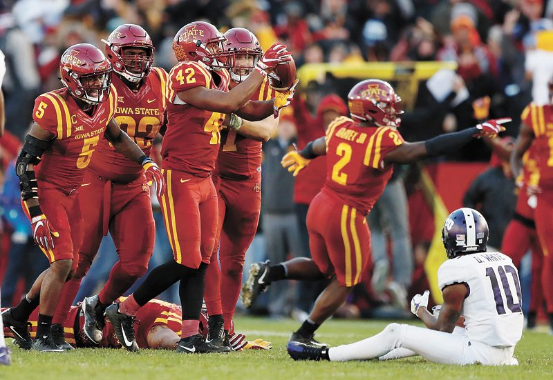 AP PHOTO • Iowa State linebacker Marcel Spears Jr. (42) celebrates with teammates after intercepting a pass in front of TCU wide receiver Desmon White (10) during the second half of a Big 12 Conference football game Saturday at Jack Trice Stadium in Ames. Iowa State won 14-7.