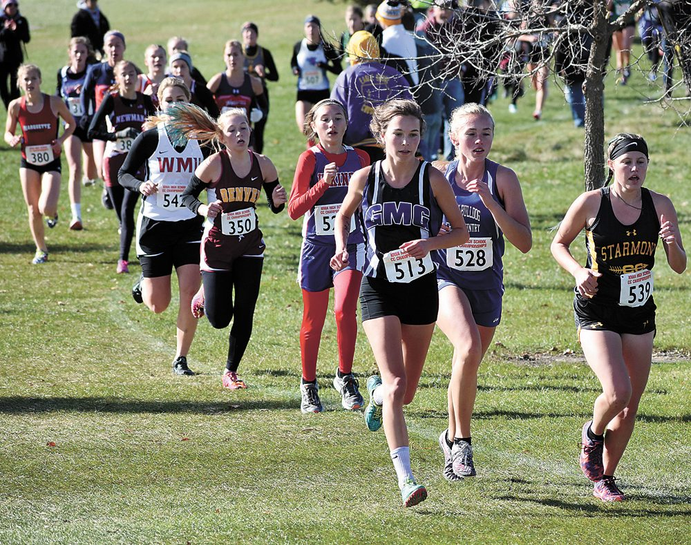 T-R PHOTO BY THORN COMPTON • GMG senior Kyla Wilkening runs with the pack during the early going of the Iowa High School State Cross Country Championships on Saturday. Wilkening finished in 10th in the Class 1A girls race, earning a podium finish in her final race as a Wolverine.