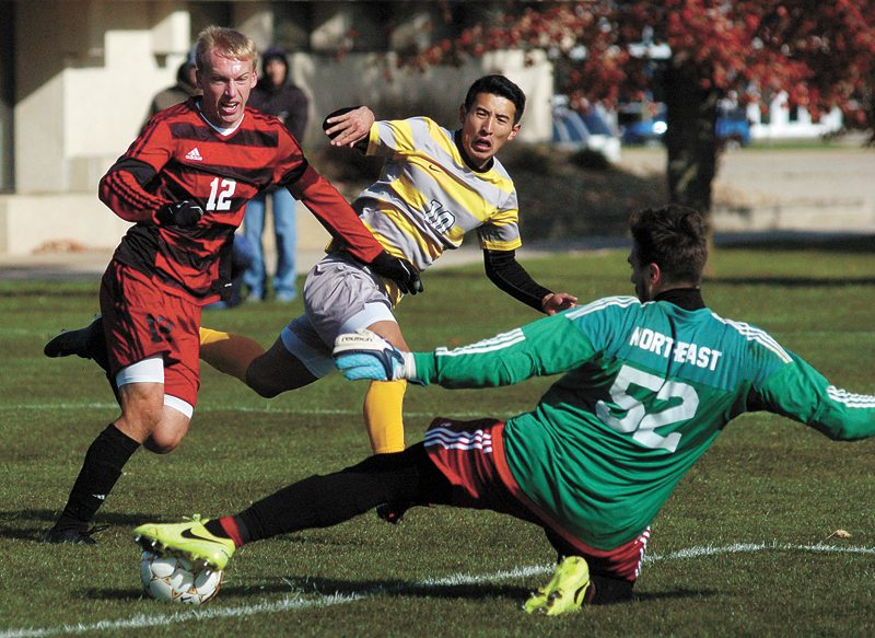 T-R PHOTO BY ROSS THEDE • Marshalltown Community College sophomore Kino Ryosuke (10) has his shot turned away by Northeast goalkeeper Massimiliano Simonazzi (52) as Aaron Wilken (12) defends during the second half of Saturday's Region XI soccer match at MCC.