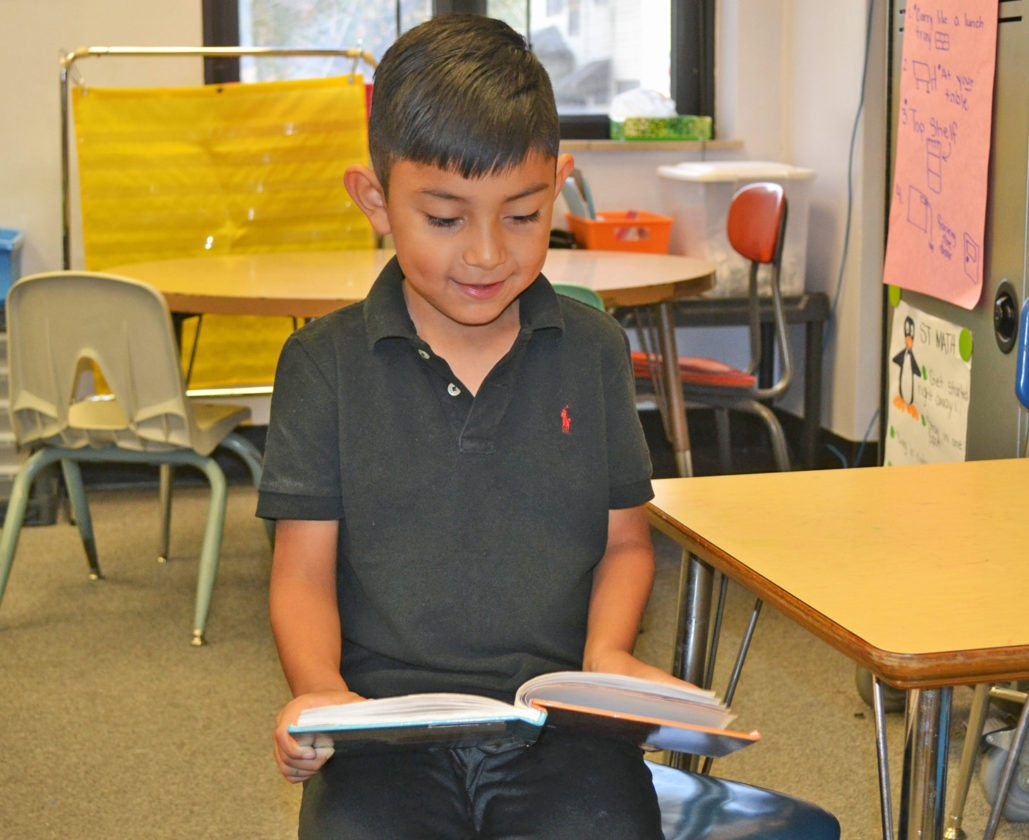 T-R PHOTO BY SARA JORDAN-HEINTZ Antonio Martinez Ramirez, 6, a first grader at Rogers Elementary School, is known as a polite, hardworking young student. In just four weeks, he moved up four reading levels. When he grows up, he would like to be a lawyer.