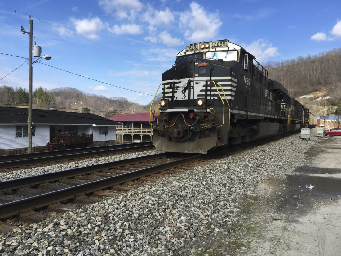 FILE - In this Feb. 16, 2017 file photo, a Norfolk Southern coal train runs through Kermit, WV. Norfolk Southern Railway must replace millions of defective wooden railroad ties on its tracks because they're degrading faster than expected, the company said in a federal lawsuit filed in October 2017 in U.S. District Court in Alabama. Norfolk Southern Railway blames an Alabama company that produced its railroad ties of failing to use proper protective coating on more than 4.7 million of them. (AP Photo/Michael Virtanen, File)