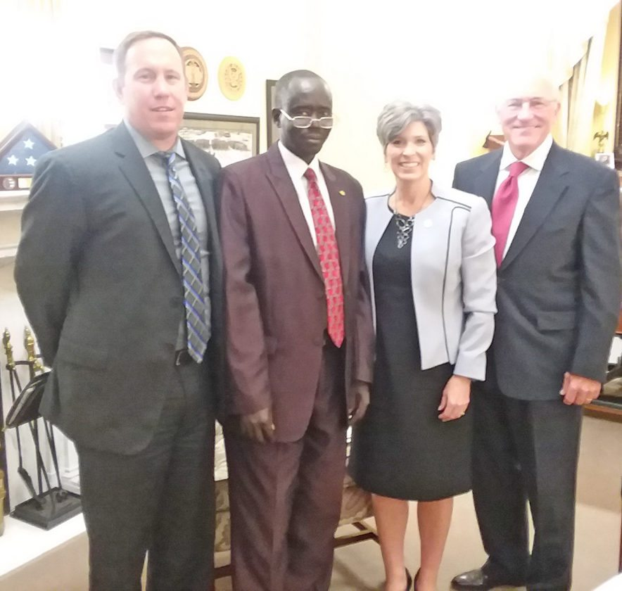 CONTRIBUTED PHOTO   A Wellsprings Mission delegation visited U.S. Sen. Joni Ernst in her Washington, D.C. office earlier this month to convey concerns about the civil war in South Sudan. From left are Matt Streeter of State Center, James Maluit Ruach of Omaha, Neb., Sen. Ernst, and Greg Brown of Marshalltown.