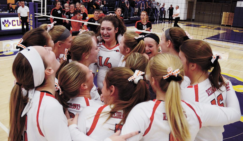 T-R PHOTO BY ROSS THEDE • Members of the North Tama volleyball team celebrate after sweeping Coon Rapids-Bayard in three sets to earn the Redhawks' first-ever state tournament appearance. Eighth-ranked North Tama topped the Crusaders 25-10, 25-18, 25-18 in Tuesday's Class 1A Region 4 final at Nevada High School.