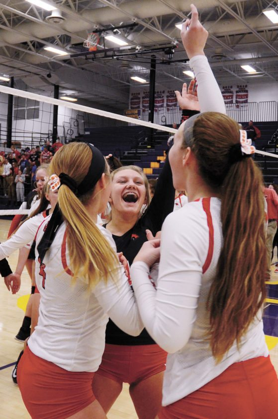 T-R PHOTO BY ROSS THEDE • North Tama's Isabel Sierra, left, Takoa Kopriva, center, and Katie Kopriva celebrate after the eighth-ranked Redhawks booked the school's first state tournament berth by beating Coon Rapids-Bayard in Tuesday's Class 1A Region 4 final at Nevada High School.
