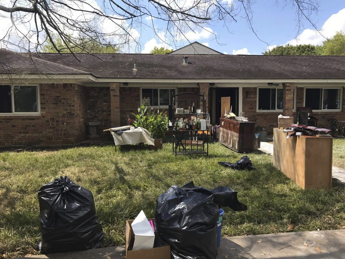 This Sept. 16, 2017 photo provided by Brianne Bueno shows the home of Beatrice and Dominique Gerard, which was damaged by flooding during Hurricane Harvey In Angleton, Texas. Bueno, Gerards' granddaughter, helped organize a raffle on Facebook in which her family gave away two World Series tickets they had bought in order to raise money to help repair the Gerard's home. The fundraising effort which collected about $10,000, was one example of the economic boost the Astros' run to a World Series championship provided to local families and businesses in the wake of Harvey. (Brianne Bueno via AP)