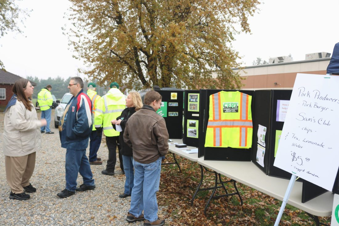 Gloomy weather didn't keep members of the public from coming to the Marshall County Sheriff's Office for a Community Emergency Response Team (CERT) fundraiser Saturday morning. Along with information on CERT, guests enjoyed fresh pork burgers and got a close-up look at equipment used by the organization.
