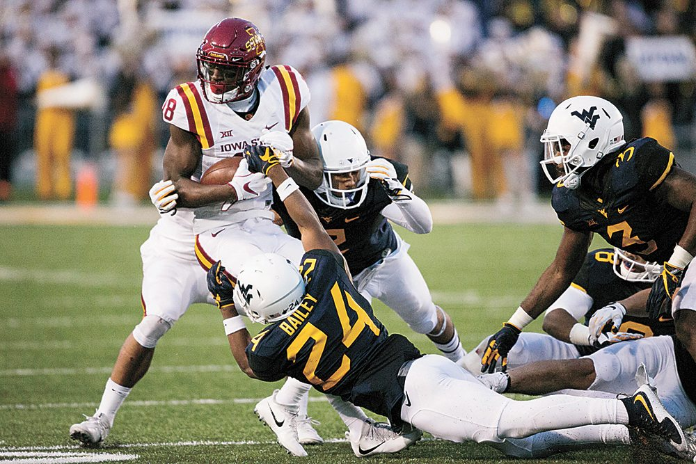 AP PHOTO • Iowa State wide receiver Hakeem Butler (18) is brought down by West Virginia's Hakeen Bailey (24) during the second half of a Big 12 Conference football game Saturday in Morgantown, W.Va.