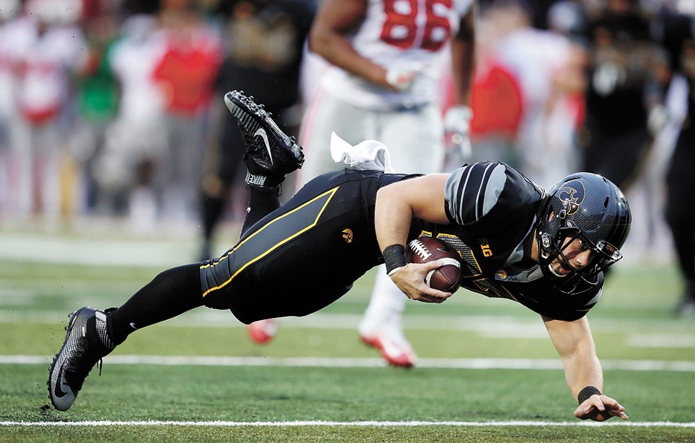 AP PHOTO • Iowa long snapper Tyler Kluver dives toward the goal line after catching a pass on a fake field goal during the second half of Saturday's game in Iowa City. The Marshalltown native gained 18 yards on his first career reception.