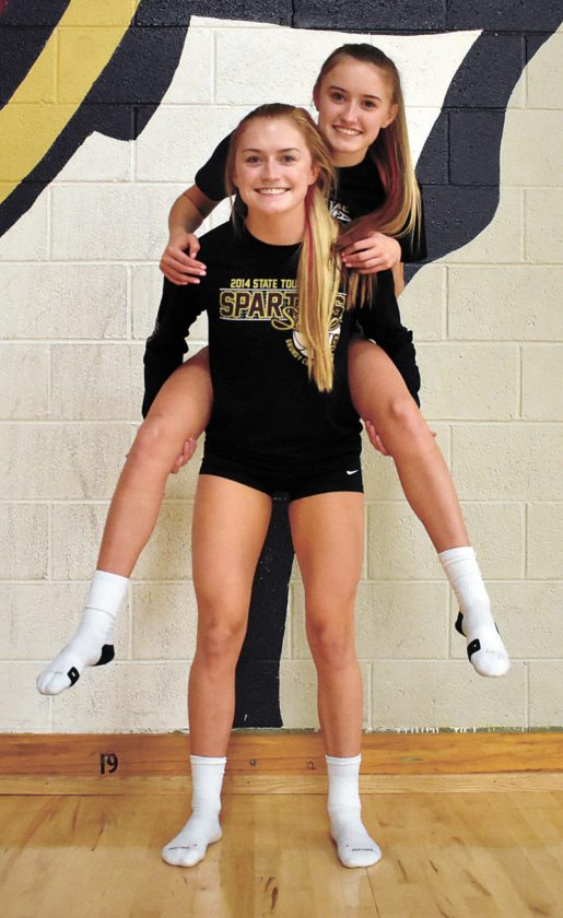T-R PHOTO BY THORN COMPTON • Grundy Center senior Landry Luhring gives her sister Kyah a piggyback ride after Monday's practice. The Luhring sisters play in the state tournament for the second time as a pair starting on Wednesday.