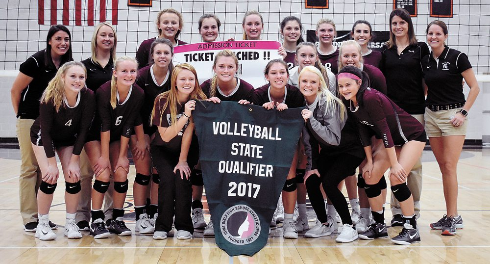 T-R PHOTO BY THORN COMPTON • The Grundy Center volleyball team poses after earning its seventh state tournament berth in the last eight years on Oct. 31 in Grinnell. Pictured are, first row: (from left) Jessica Ayers, Lauren Wegmann, Sabrina Mast, Landry Luhring, Hannah Stahl, Chasyti Erickson and Abby Hamann; second row: coach Heather Gutnecht, coach Alison Steinmeyer, Sydney Mathews, Kyah Luhring and Frannie Brown; third row: Leslie Homeister, Kylie Willis, Brooke Flater, Claire Verly, Emerson Kracht, Hailey Wallis, coach Danielle Schmidt and head coach Lori Willis.