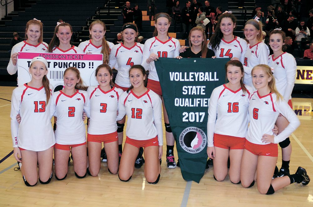 T-R PHOTO BY ROSS THEDE • The North Tama volleyball team poses with its first-ever state qualifier banner on Oct. 31 in Nevada. Pictured are, front row: (from left) Alexis Hansen, Megan Popelka, Dylan Rohlfsen, Abby Deboef, Rylee McLean and Madison Stoneking; back row: Andrea Ubben, Carissa Calderwood, Karly Jans, Isabel Sierra, Katie Kopriva, Takoa Kopriva, Lydia Schafer, Carlie Gorder and Katelyn Kucera.