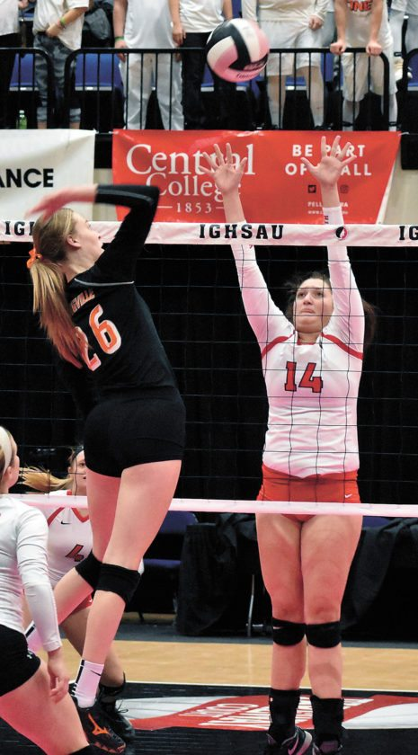 T-R PHOTO BY THORN COMPTON • North Tama senior Lydia Schafer (14) tries for the block against Springville's Samantha Johnson (26) during their quarterfinal match.