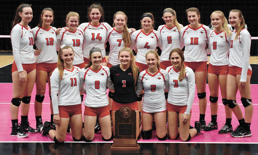 T-R PHOTO BY THORN COMPTON • The North Tama volleyball team poses with the school's first-ever state tournament qualifier trophy after Wednesday's Class 1A quarterfinal loss to Springville. Pictured are, front row: (from left) Carissa Calderwood, Katelyn Kucera, Takoa Kopriva, Megan Popelka and Dylan Rohlfsen; back row: Katie Kopriva, Abby Deboef, Andrea Ubben, Lydia Schafer, Karly Jans, Isabel Sierra, Carlie Gorder, Rylee McLean, Madison Stoneking and Alexis Hansen.