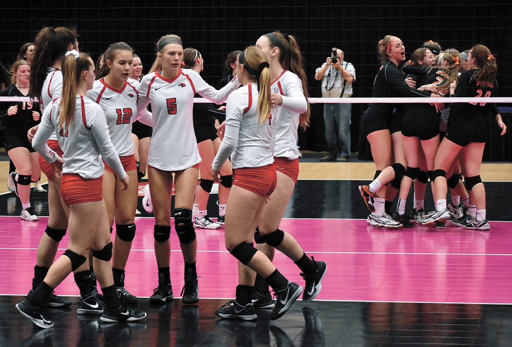 T-R PHOTO BY  THORN COMPTON • Members of the North Tama volleyball team come together for a final group huddle after falling in three sets to Springville in the opening round of Class 1A play at the Iowa Girls' High School State Tournament on Wednesday night at the U.S. Cellular Center in Cedar Rapids. The eighth-ranked Redhawks were dropped in three sets in their state tournament debut, falling 25-15, 25-21, 25-21.