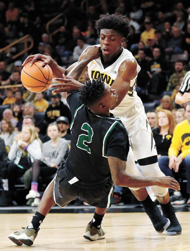 AP PHOTO • University of Iowa forward Tyler Cook is fouled by Chicago State guard Jelani Pruitt (2) during the first half of a college basketball game at Carver-Hawkeye Arena in Iowa City. Cook had 12 points to help the Hawkeyes beat the Cougars 95-62.