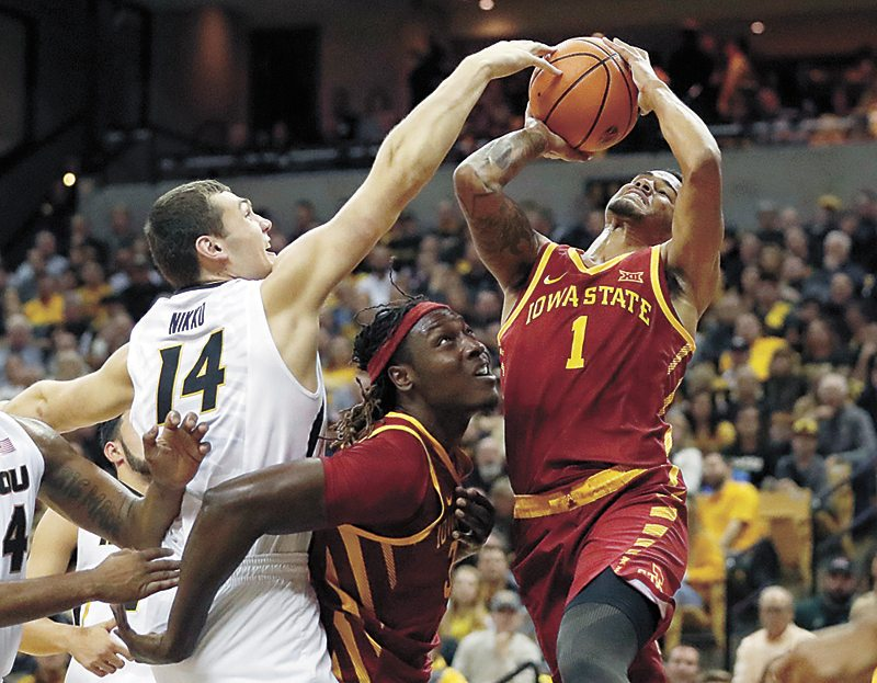 AP PHOTO • Missouri's Reed Nikko (14) blocks a shot by Iowa State's Nick Weiler-Babb (1) as Solomon Young, center, watches during the first half of a college basketball game Friday in Columbia, Mo.