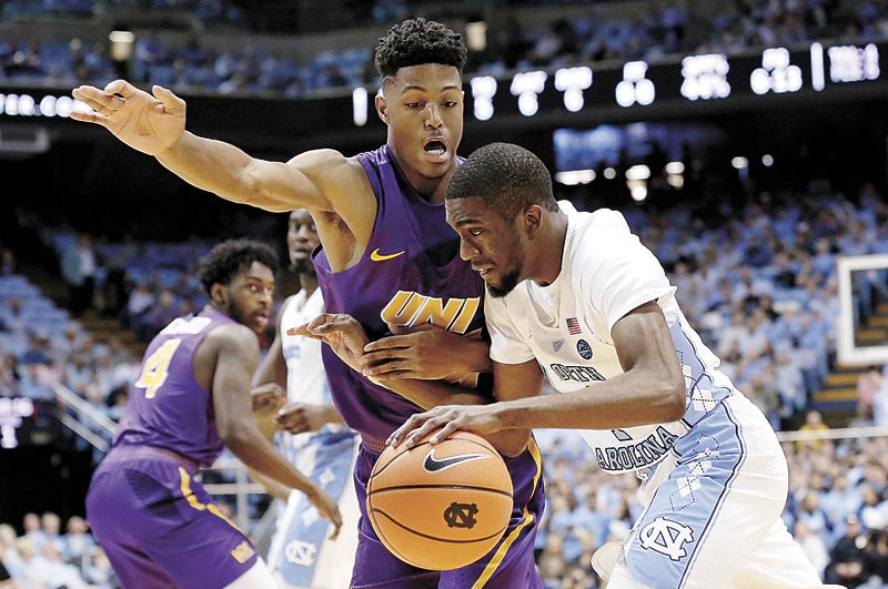 AP PHOTO • North Carolina's Brandon Robinson, right, drives past Northern Iowa's Isaiah Brown during the first half of a college basketball game Friday in Chapel Hill, N.C.