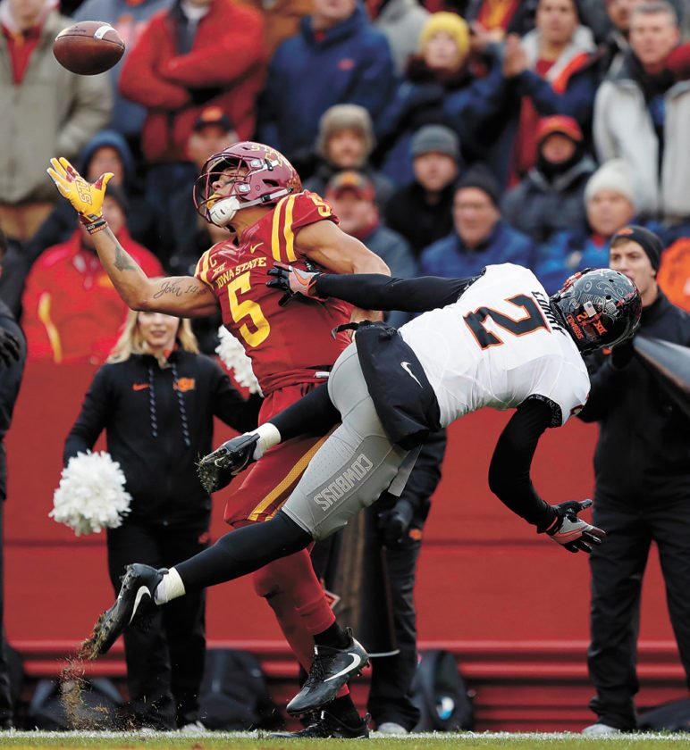 AP PHOTO • Iowa State wide receiver Allen Lazard (5) makes a one-handed catch for a 22-yard touchdown in front of Oklahoma State cornerback Darius Curry (2) during the second half of a Big 12 Conference football game Saturday at Jack Trice Stadium in Ames. Oklahoma State won 49-42.