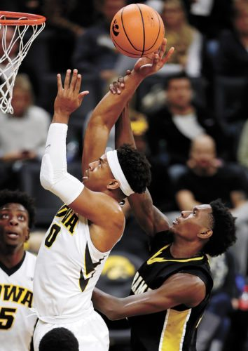 AP PHOTO • Iowa forward Ahmad Wagner (0) is fouled by Alabama State forward Ed Jones during the second half of a college basketball game Sunday at Carver-Hawkeye Arena in Iowa City.