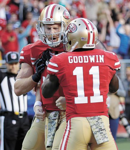 AP PHOTO • San Francisco 49ers quarterback C.J. Beathard, left, is congratulated by Marquise Goodwin (11) after scoring a touchdown against the New York Giants during the second half of an NFL game Sunday in Santa Clara, Calif.