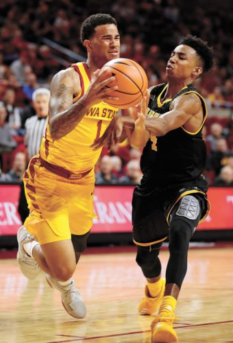 AP PHOTO • Iowa State guard Nick Weiler-Babb is fouled by Milwaukee guard Jeremy Johnson, right, while driving to the basket during the first half of a college basketball game Monday at Hilton Coliseum in Ames.