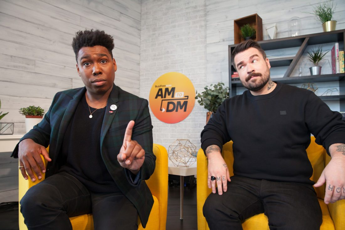 """This image released by Buzzfeed shows Saeed Jones, left, and Isaac Fitzgerald, cohosts of BuzzFeed News AM to DM. Launched quietly in late September from a studio in BuzzFeed's Manhattan office, """"AM to DM"""" is a breezy mix of news and pop culture. Viewers can click on Twitter and watch the stream live, or catch highlights later in the day.  (Drew Reynolds/Buzzfeed via AP)"""