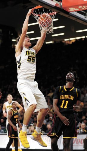 AP PHOTO • Iowa forward Luka Garza (55) dunks over Grambling State forward Axel Mpoyo (11) during the second half of a college basketball game Thursday at Carver-Hawkeye Arena in Iowa City. Iowa won 85-74.