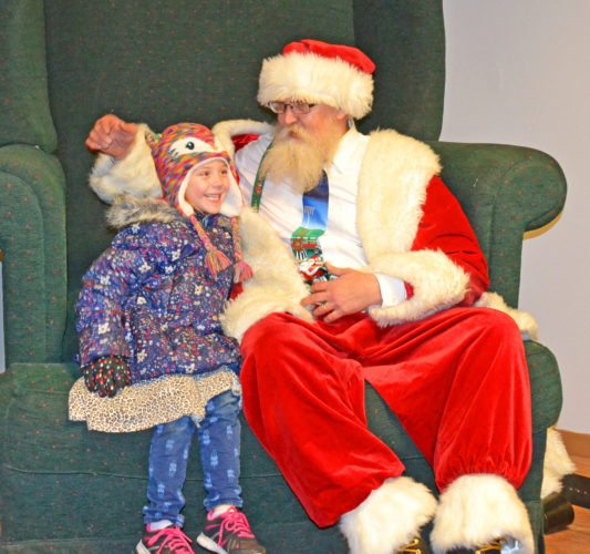 The 26th annual Holiday Stroll was held in downtown Marshalltown Saturday afternoon and evening. The T-R sponsored a Santa's Workshop, wherein Suzanne Hargan, 6, told Santa all she wanted for Christmas.