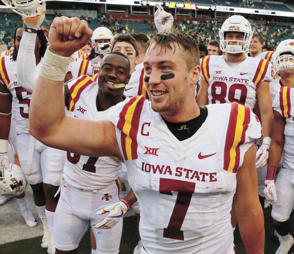 AP PHOTO • Iowa State quarterback Joel Lanning (7) celebrates the Cyclones' win over Baylor as well as his 23rd birthday after a Big 12 Conference football game Saturday in Waco, Texas. Iowa State won 23-13.