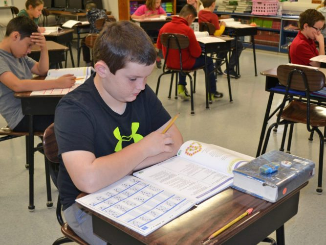 Owen Eaton, 11, a fifth grader at St. Francis Catholic School, completes advanced level coursework, with the goal of mastering seventh and eighth grade math. When he grows up, he would like to be a long snapper for the Denver Broncos.