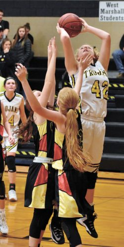 T-R PHOTO BY THORN COMPTON • West Marshall sophomore Teresa Disney (42) makes a post move on Iowa Falls-Alden juniors Madalyn, center, and Grace Juhl on her way to leading the Trojans in scoring during their 52-36 win over the Cadets on Tuesday.