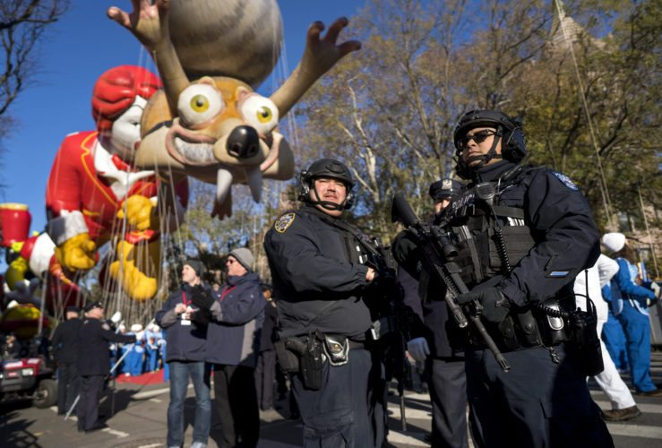 Heavily-armed members of the New York Police Department take a position along the route before the start of the Macy's Thanksgiving Day Parade in New York, Thursday, Nov. 23, 2017. (AP Photo/Craig Ruttle)