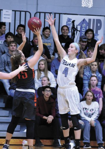 T-R PHOTO BY THORN COMPTON • South Tama junior Jaelin Berger (4) goes up for a block against Grinnell's McKenna McKnight (45) during the Trojans' 76-40 home loss to the Tigers on Monday night.
