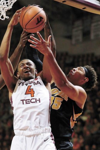 AP PHOTO • Virginia Tech's Nickeil Alexander-Walker (4) grabs a rebound in front of Iowa's Cordell Pemsl (35) in the first half of a college basketball game Tuesday in Blacksburg, Va.