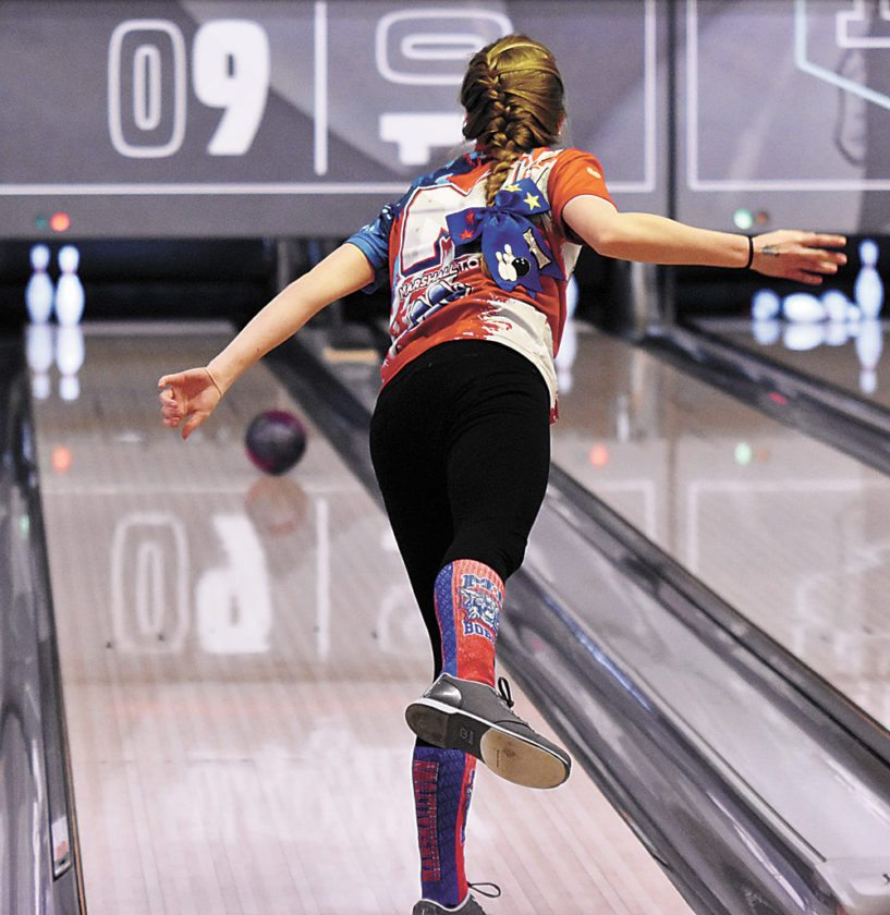 T-R PHOTO BY THORN COMPTON • Marshalltown bowler Haley Bell stares her ball down as it rolls toward a spare on Tuesday during the Bobcats' comeback win in their dual against Southeast Polk. The MHS girls also beat Bondurant-Farrar in the home opener.
