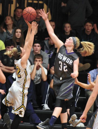 T-R PHOTO BY THORN COMPTON • AGWSR junior Taryan Barrick, right, contests a shot by West Marshall senior Emma Meyer during the second quarter of the Cougars' 52-43 win over the Trojans on Friday night.
