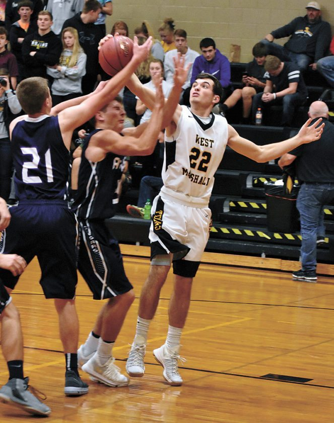 T-R PHOTO BY THORN COMPTON • West Marshall's Josh Larsen (22) battles for a rebound with AGWSR's Alex Hames (21) during Friday's NICL West Division basketball game in State Center.